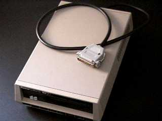 picture of the Xformer Cable and an 8-bit disk drive